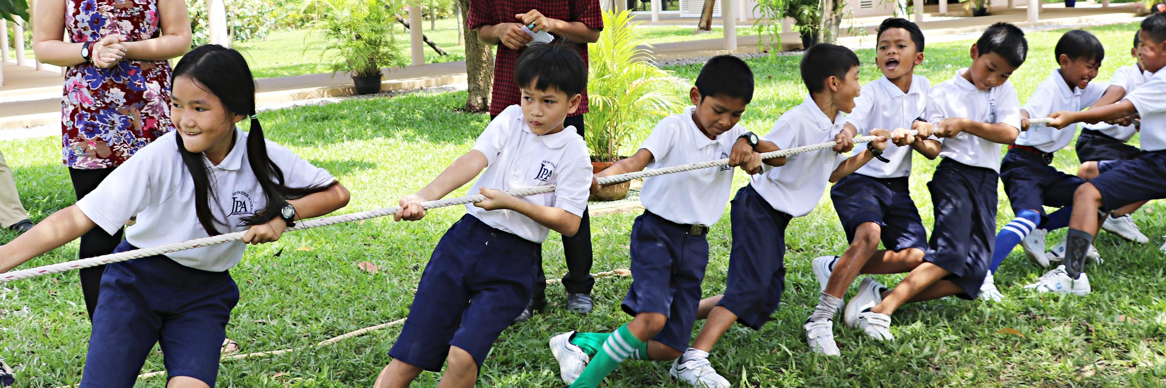 Jay Pritzker Academy, Siem Reap, Cambodia. JPA students playing tug-of-war during Khmer Pchum Ben celebrations at the JPA campus. Jay-Pritzker-Academy-Siem-Reap-Cambodia.