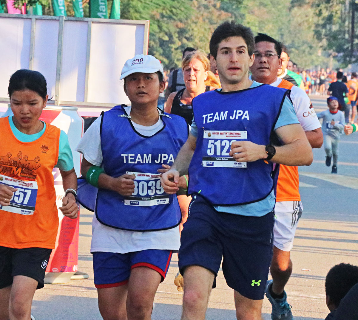 JPA student and teacher competing in the 24th Angkor Wat International Half Marathon 2019. Jay Pritzker Academy, Siem Reap, Cambodia. Jay-Pritzker-Academy-Siem-Reap-Cambodia.